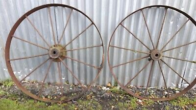 pair of vintage steel / cast iron wheels horse drawn farm machinery very old