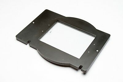 "Omega Glass Negative Carrier For D Enlarger-4"" x 5"" small crack in glass at edge"