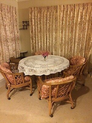 cane dining table and 4 chairs