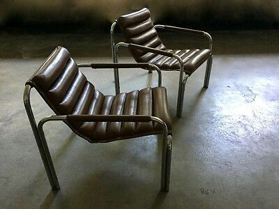 Mid century chrome chairs with brown leatherette.