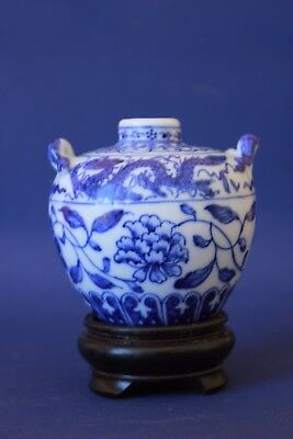 Chinese blue & white dragon vase with stand.