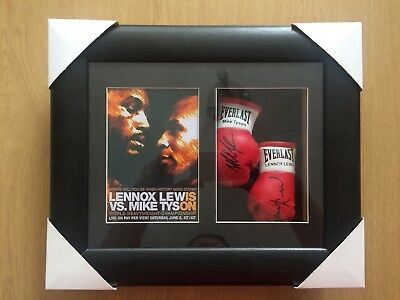 Signed Boxing gloves (reprints) in display case by Lennox Lewis and Mike Tyson