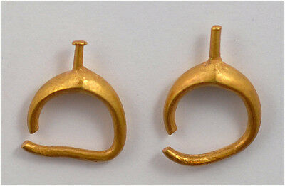 Roman a pair of golden earrings