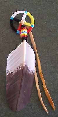 Medicine wheel with beaded warrior feather