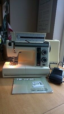 New Home (Janome) electric sewing machine with instruction manual.