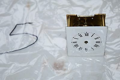antique french clock  movement and enamel dial small movement