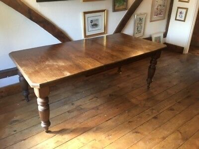 Solid Oak Extendable Victorian Dining Table. Seats up to 12. One caster missing.
