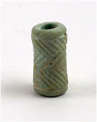 Egypt Late Period A blue faience cylinder seal