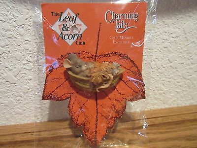 Charming Tails Mackenzie Sleeping in a Nut Lapel Pin