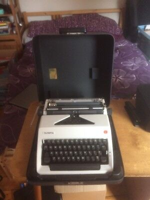 Olympia portable Typewriter vintage working condition.
