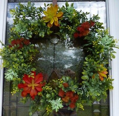 Fall wreath with artificial succulent autumn colors