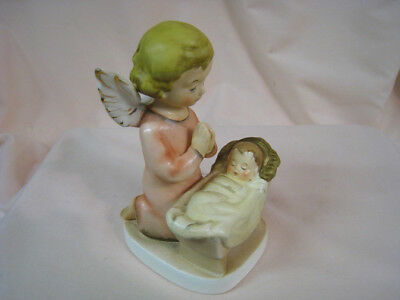 Hand Painted Angel Praying over Baby in Cradle Figurine