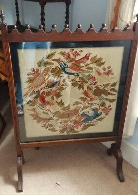 very large antique fire screen depicting colourful bird pattern