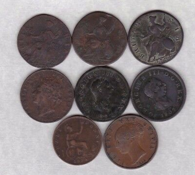 Eight Old Copper Halfpennies Dated 1734 To 1874 In A Well Used Condition