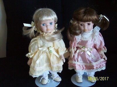 Two Beautiful Vintage Porcelain Dolls On Stands.
