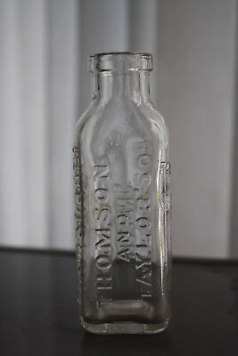 Vintage Embossed Thompson & Taylor Root Beer Extract BOTTLE