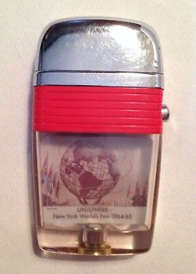 1964-1965 New York World's Fair Unisphere and AMF Monorail Scripto Lighter