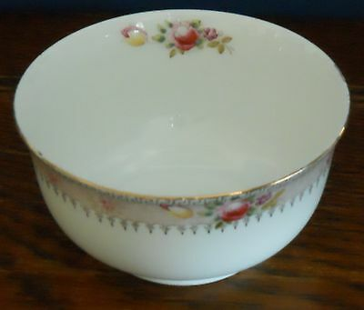 A small Edwardian / Antique  bowl by Samuel Radford  hand coloured Luton Pattern