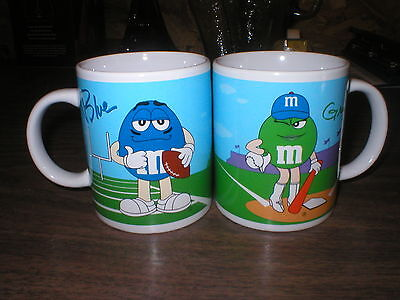 2 M&M SPORTS CUPS / MUGS GALERIE; Red Blue Yellow Green Golf Baseball Football