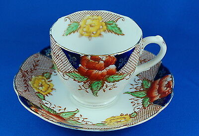 Bell China Cobalt Blue Lattice Pattern Orange & Yellow Peony Teacup & Saucer