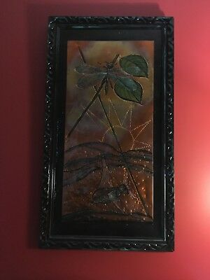 metal art of dragonfly and fish