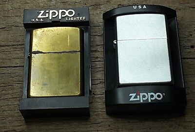 Pair of vintage Zippo Lighters Gold never lit Silver Sealed and New