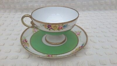 Pretty Hand Painted And Gilded Noritake Pedestal Cup And Saucer.