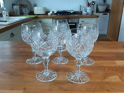 Stunning believed Stuart crystal wine glasses. Heavy. Marked S. 6inch high.