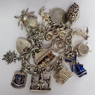 Amazing vintage solid silver charm bracelet & rare silver charms(open,move),1964