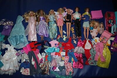 Amazing bundle of Barbie and Ken and little children+accessories (shoes,clothes)