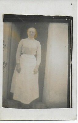 Unidentified lady  in doorway, posted Ely 1916