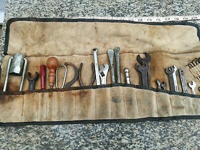 a vintage tool roll and tools