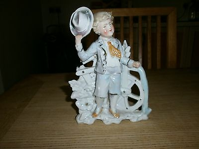 staffordshire figurine  of a decorative young boy
