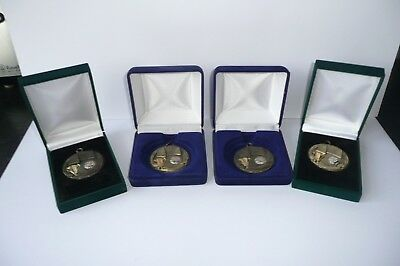 Four football medals boxed