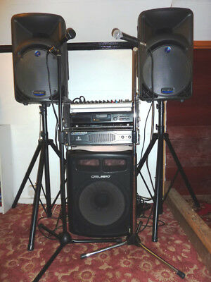 Full  PA System -  mixer, power amp, speakers & stands,  sub, 2 mics & stands