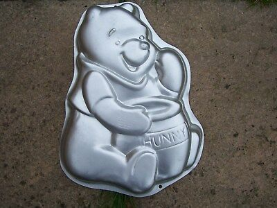 From Disney Silver Coloured Winnie The Pooh Shaped Cake Tin