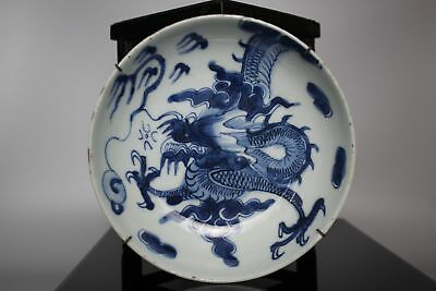 A Chinese blue & white dragon dish with seal mark to base 17th/18thc