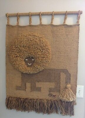 Don Freedman Lion Fiber Art Wall Hanging Mid Century 1970s with clay medallion.