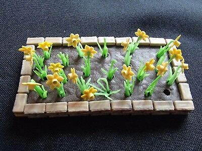 Britains Floral garden flower bed with daffodils and edging bricks