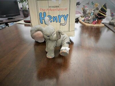 TUSKERS ELEPHANTS...Henry kiss it better