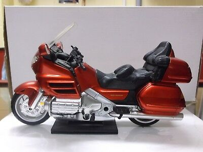A Diecast and plastic model of a Honda Goldwing 1800 1/12th scale Motorcycle.
