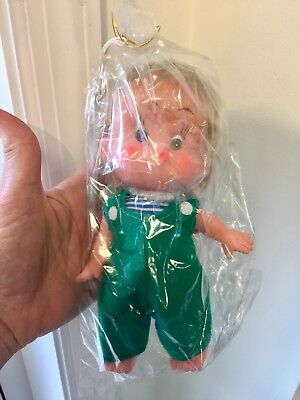 Vintage Forsum Japan Vinyl Doll with Wrapping & Tag Green Felt Overalls  NOS