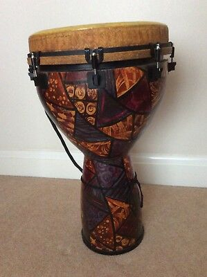 """remo 14"""" djembe preowned complete with 'protection racket' case."""