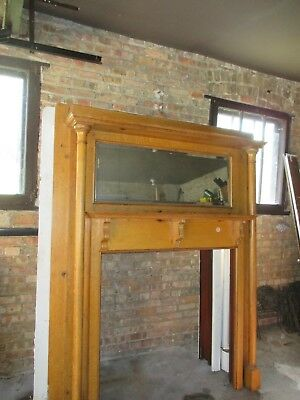 Vintage fireplace surround and mantle with beveled mirror
