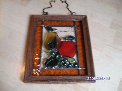 Wooden framed stained glass window showing fruit
