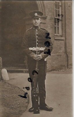 Soldier Regular battalion Norfolk Regiment outside barracks wears full dress