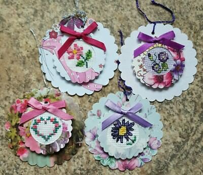 4 Completed hand crafted cross stitch floral gift tags, card toppers
