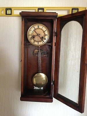 antique german wall clock two hole ceramic face