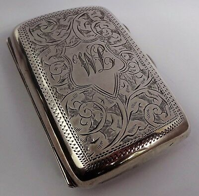 Fabulous hand chased solid sterling silver cigarette case, gilt interior. 1922