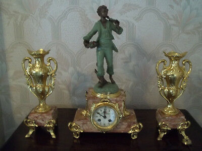 Antique French Figural Clock With Garniture.